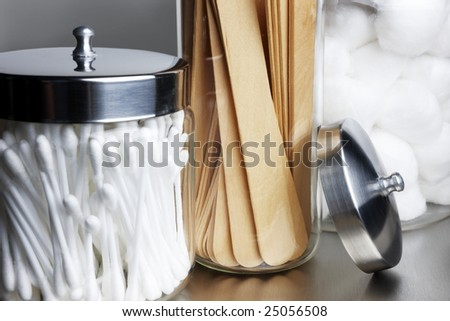 Cotton swabs and balls, tongue depressors on a stainless steel background - stock photo