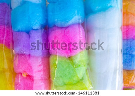 Cotton sweet candy in plastic bags - stock photo