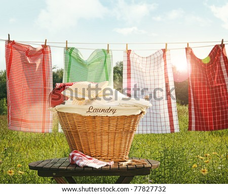 Cotton towels drying on the clothesline with sunny blue sky - stock photo