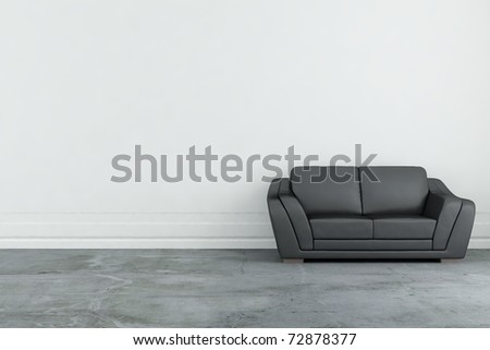 Couch to face a blank wall - stock photo