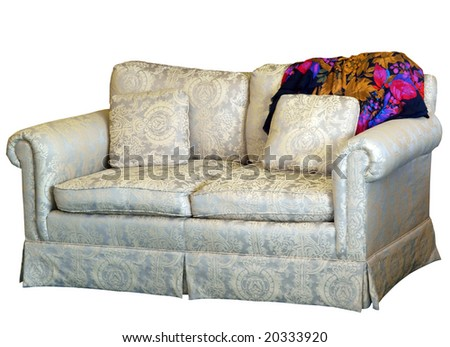 Couch with Cushion with Colorful Rug isolated with clipping path - stock photo