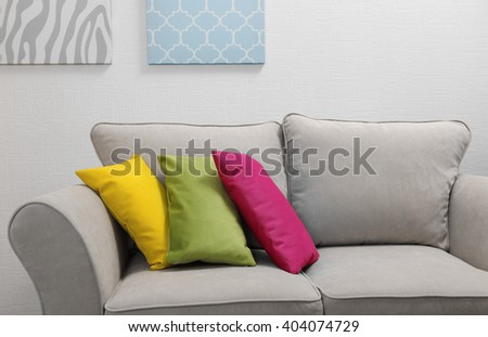 Couch with pillows in light room
