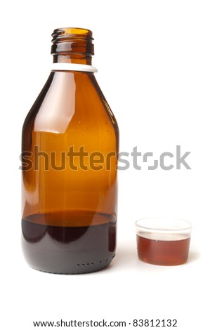 Cough syrup in a bottle with dosage cup for drinking filled up - stock photo
