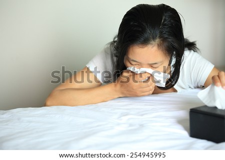 cough woman sneeze nose beside bed  - stock photo