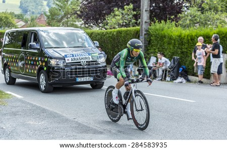 COULOUNIEIX-CHAMIERS,FRANCE-JUL26:The Japanese cyclist Yukiya Arashiro (Europcar Team) pedaling during the stage 20 ( time trial Bergerac - Perigueux) of Le Tour de France 2014.  - stock photo