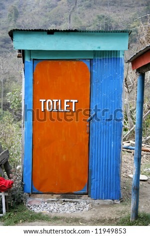 coulourful outside toilet on annapurna circuit, nepal - stock photo