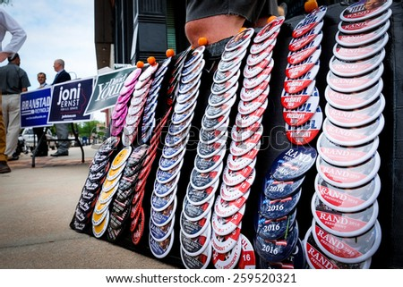 COUNCIL BLUFFS, IA - AUGUST 4: Seth D  sells Rand Paul buttons outside the Pottawattamie County Republican headquarters  August 4, 2014 in Council Bluffs, Iowa.  - stock photo