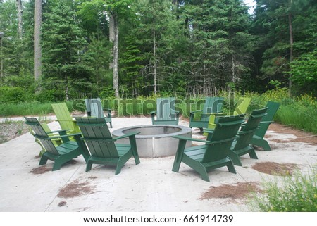 Council Fire In The Pines With Green Adirondack Chairs. Adult And Children Chairs  Around An