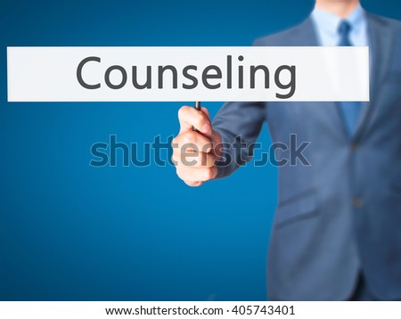 Counseling - Businessman hand holding sign. Business, technology, internet concept. Stock Photo - stock photo