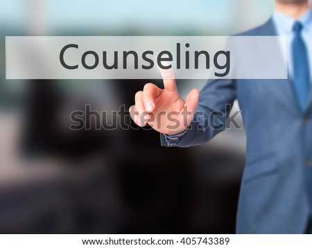 Counseling - Businessman hand pressing button on touch screen interface. Business, technology, internet concept. Stock Photo - stock photo