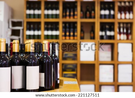 Counter of wine bottles at the wine shop - stock photo