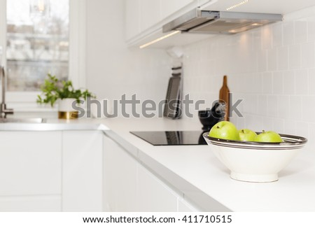 counter top in kitchen with a bowl of green apples - stock photo