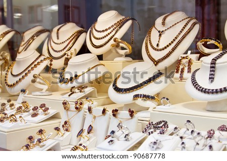 counter with garnet jewelry in store window - stock photo