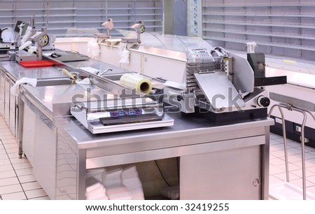Counter with trading equipment in empty shop - stock photo