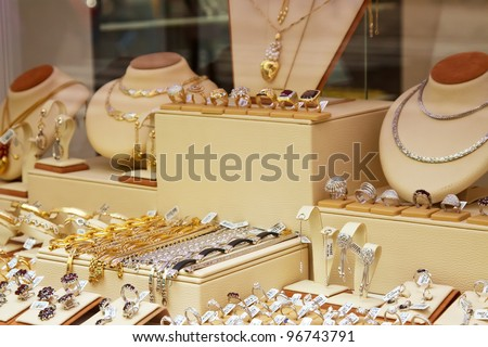 counter with variety jewelry in store window - stock photo