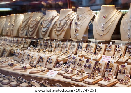 counter with variety of jewelry in store window - stock photo