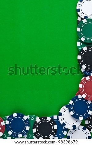 Counters for game in a casino on green a background - stock photo