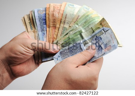 Counting arabic money in hands - stock photo