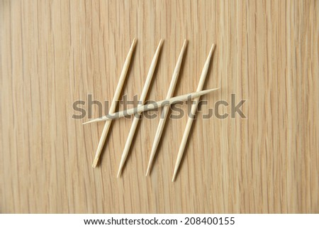 counting by toothpick - stock photo
