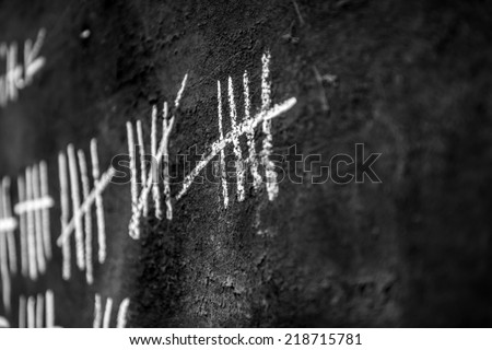 Counting days on blackboard in the jail - stock photo