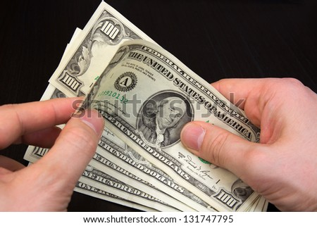 counting dollar money with two hands - stock photo