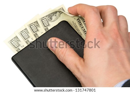 counting money in black book - stock photo