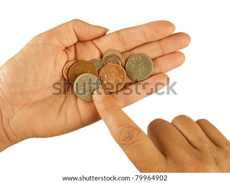 Counting small change aka coins - UK pounds sterling, poverty, hardship concept - stock photo