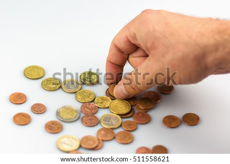 Counting the euro coins by hand.