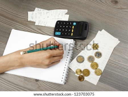 Counting the household budget - stock photo