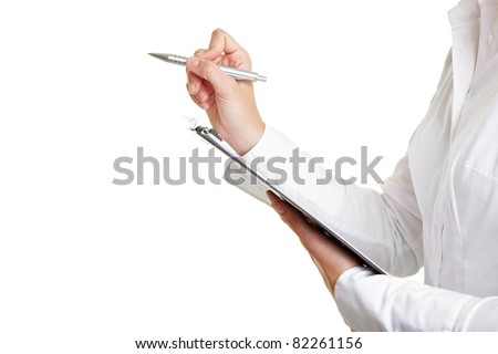Counting with pen and checklist on clipboard - stock photo