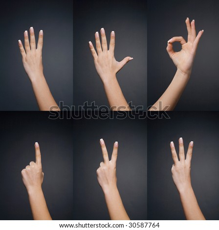 Counting woman hands (0 to 5) on black background - stock photo