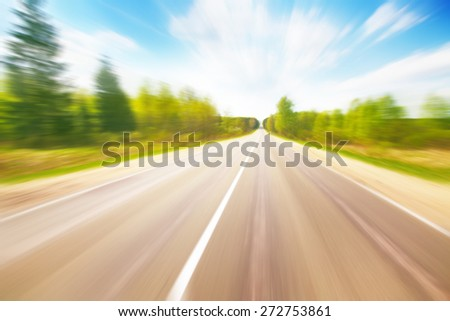 Country asphalt road in motion blur. - stock photo