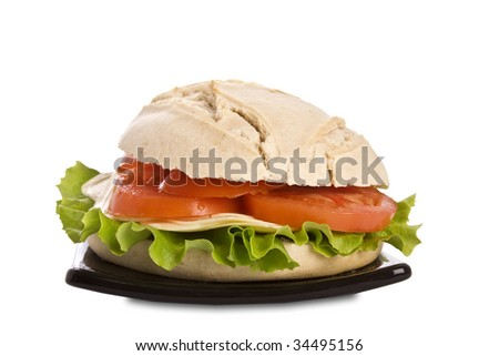 Country bread sandwich with cheese, lettuce and tomato. Isolated on white. It has a clipping path.