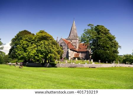 Country church; English village church in idyllic rural surroundings  - stock photo