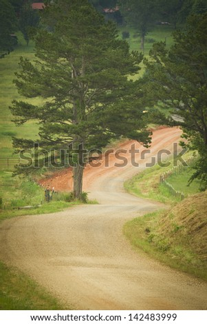 Country dirt road. - stock photo