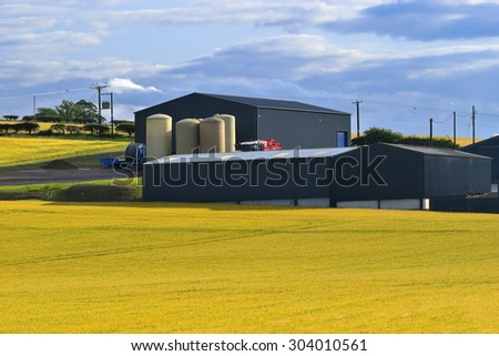 Country Farm and blue sky, England - stock photo