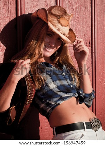 Country girl by the red barn.