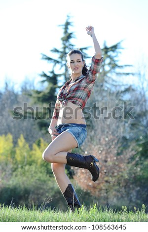 country girl having fun outdoors - stock photo