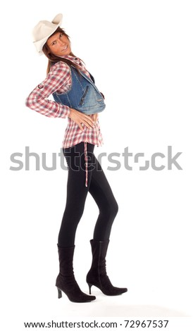 country girl in chequered shirt and bright hat with lasso - stock photo