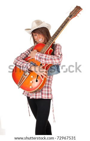 country girl in chequered shirt with bright cowboy hat and electric guitar, series