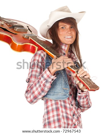 country girl in chequered shirt with bright cowboy hat and electric guitar, series - stock photo