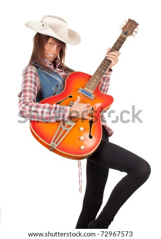 country girl in chequered shirt with bright cowboy hat playing on electric guitar, series - stock photo