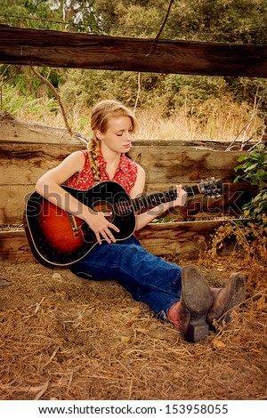 Country Girl with Guitar - stock photo