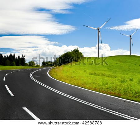 Country highway and wind turbines - stock photo