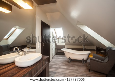 Country home - bathroom on the attic with wooden floor - stock photo