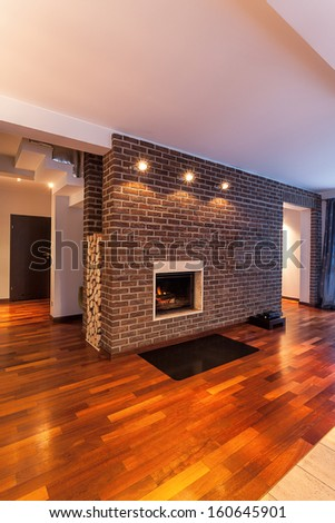 Country home - fireplace on brick wall