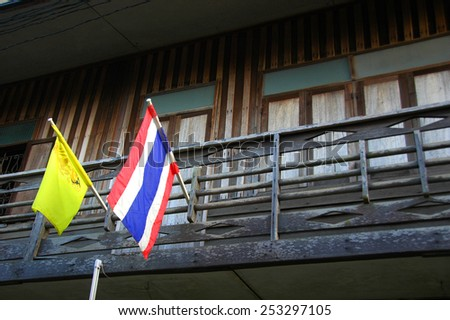 Country home in Thailand with Country and King's Flag - stock photo