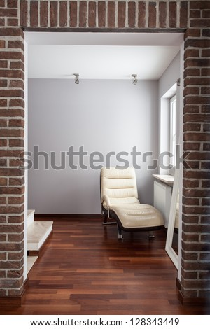 Country home - passage with comfortable chaise lounge - stock photo