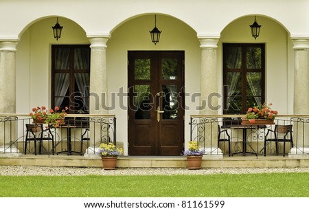 Country home terrace and its well-kept neighborhood. - stock photo