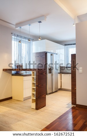 Country home - View at kitchen interior with wooden table - stock photo